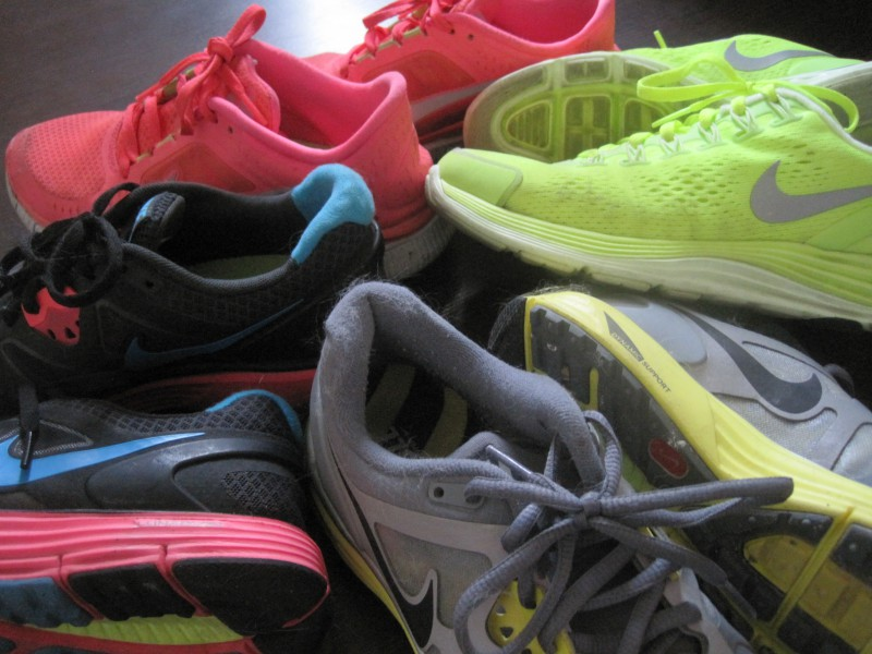 Pile of Nike running shoes