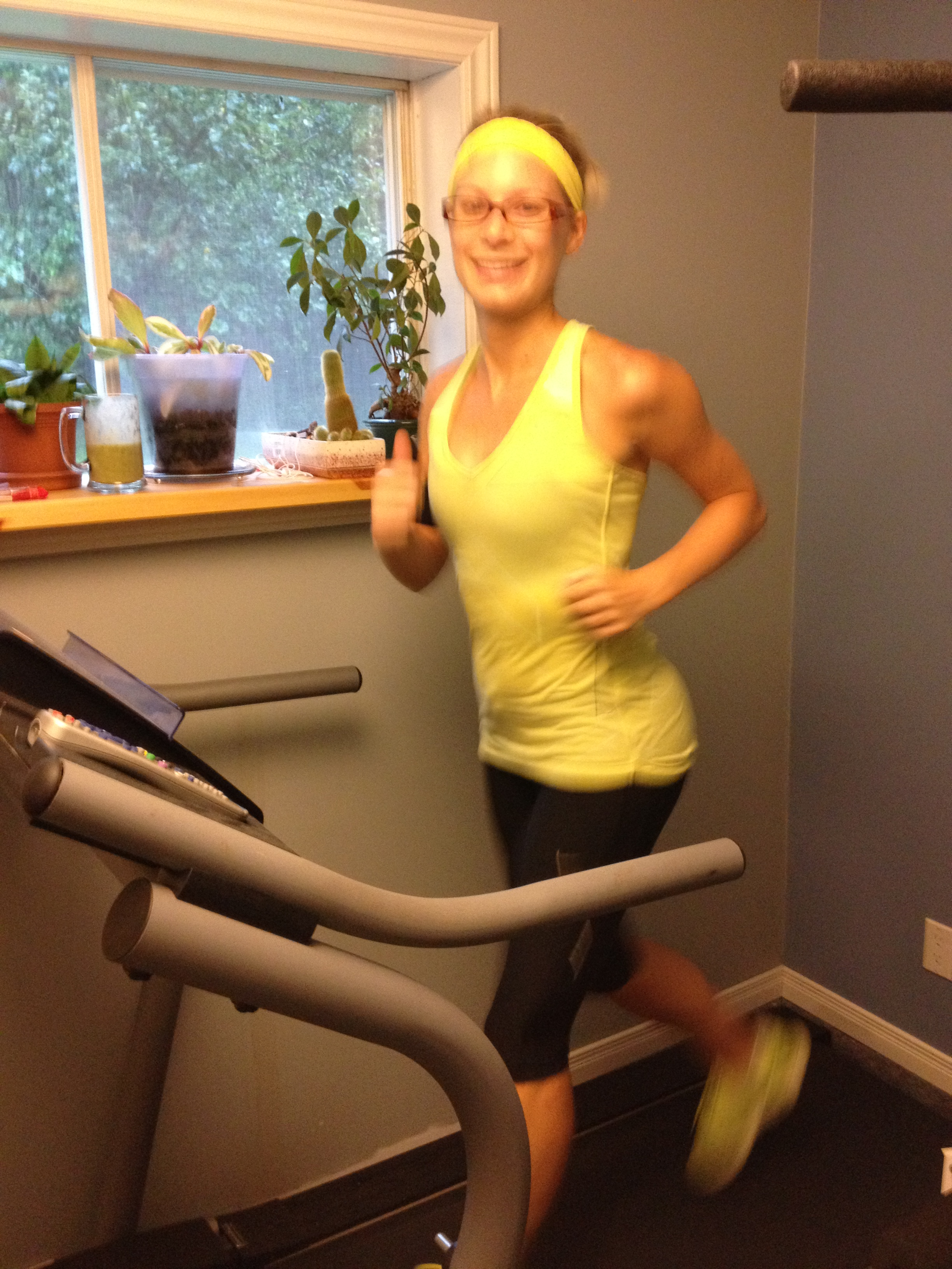 Around the 10K mark of my giant treadmill run. Wearing my glasses so I can see the TV.