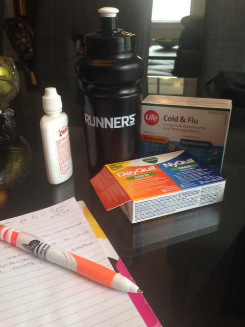 This pretty much sums it up: my Runner's World water bottle and a bunch of drugs.