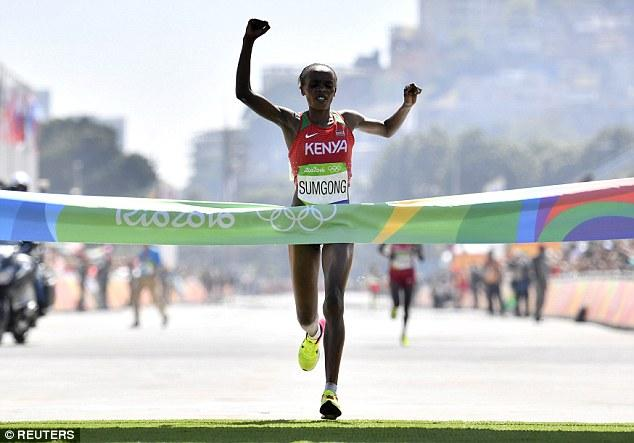 Jemima Sumgong crossing the finish line.